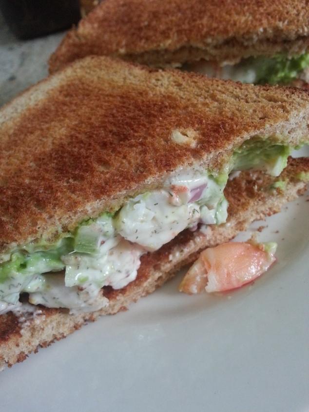 Smashed avocado and shrimp salad sandwich