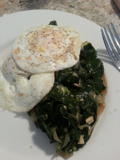 Collards and fried eggs