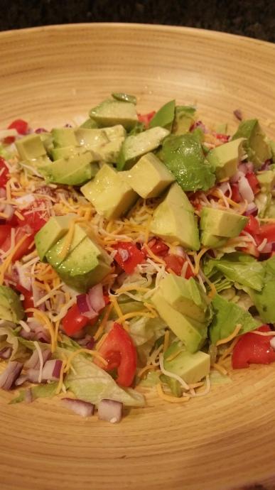 layering the taco salad