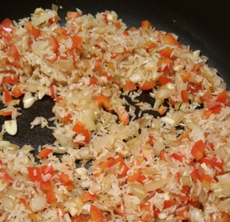 onions, peppers, garlic and rice