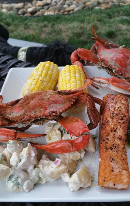 dill potato salad and crabs