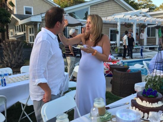 feeding cake to Travis
