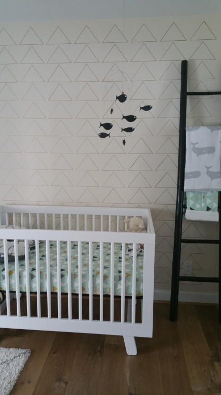 Crib and triangle accent wall